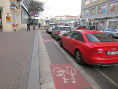 Bike lane in Prague, protected by parked vehicles